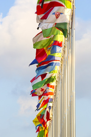 flagpoles: different countries flags on flagpoles on the sky background