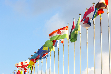 different countries: different countries flags on flagpoles on the sky background