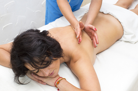 young girl doing a massage in the beauty salon Stock Photo