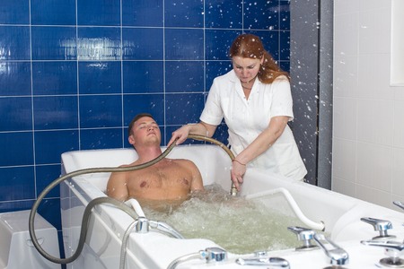 man passes procedure hydromassage