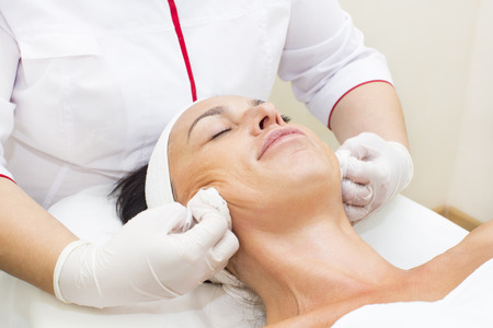 release: process of massage and facials in beauty salon