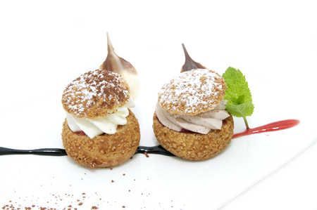 profiteroles with vanilla ice cream decorated with chocolate mint Stock Photo