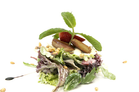 japanese cookery: Salad and Roast goose liver is decorated with greens and strawberries