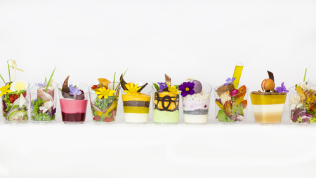 Desserts and meat canapes vegetable snacks in plastic cups canapes