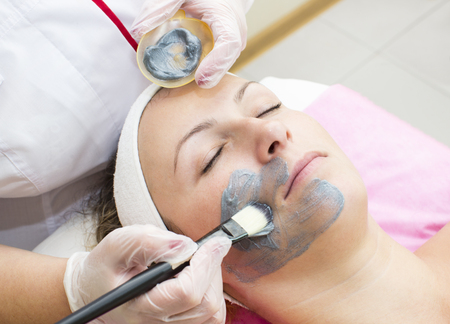 womans hand: process of massage and facials in beauty salon