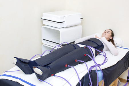 woman at the clinic for the treatment of pressure therapy procedure