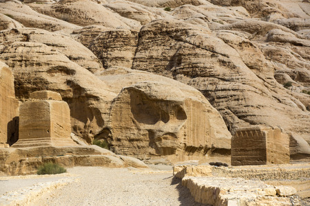 caved: Ancient abandoned rock city of Petra in Jordan tourist attraction Stock Photo