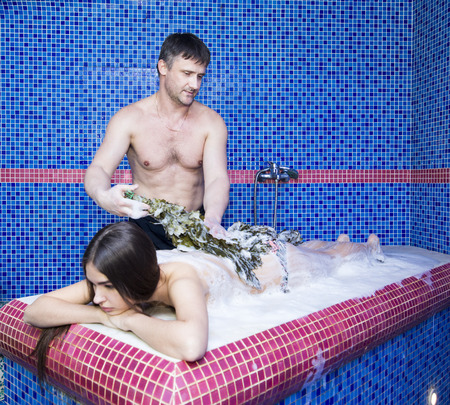 Woman on the procedure of the foam massage in the hammam Stock Photo