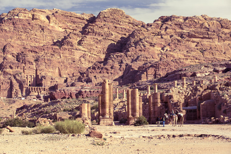 JORDAN, Ancient Petra - 10 JANUARY 2017: Tourist complex of the ancient city of Petra with tourists and locals: JANUARY 10, 2017 in Jordan. Ancient Petra