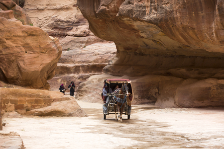 caved: JORDAN, Ancient Petra - 10 JANUARY 2017: Tourist complex of the ancient city of Petra with tourists and locals: JANUARY 10, 2017 in Jordan. Ancient Petra