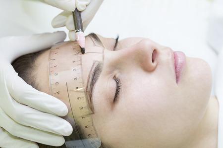 Mikrobleyding eyebrows workflow in a beauty salon Stock fotó - 73535117