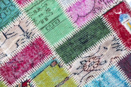 oriental rug: Texture of a piece of old carpet to sew thick threads