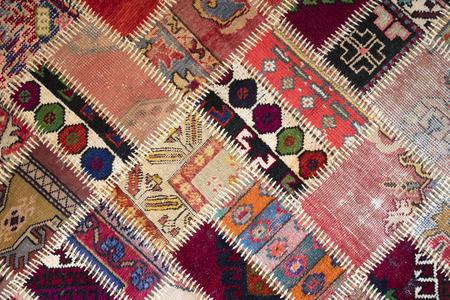 Textura de un trozo de alfombras antiguas para coser hilos gruesos Foto de archivo - 76105610