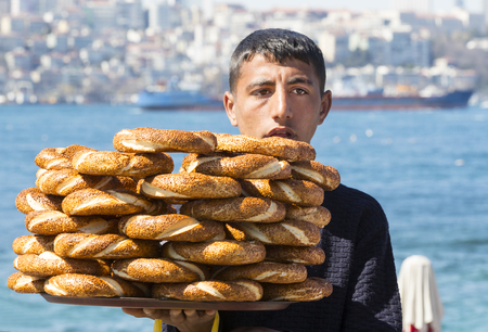 ISTANBUL, TURKEY - 5 APRIL, 2017: Street sales of traditional Turkish bagels Simit, are on the streets of Istanbul in Turkey Editorial