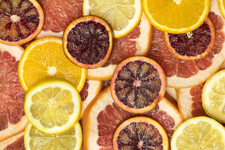 Background citrus ripe juicy slices of orange lemon shot close-up Stock Photo