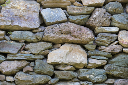 Background of an old stone brick wall closeup