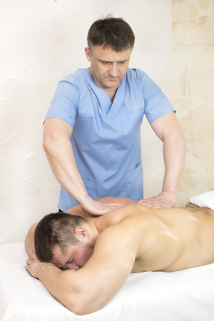 young man on wellness treatments sports massage Stock Photo