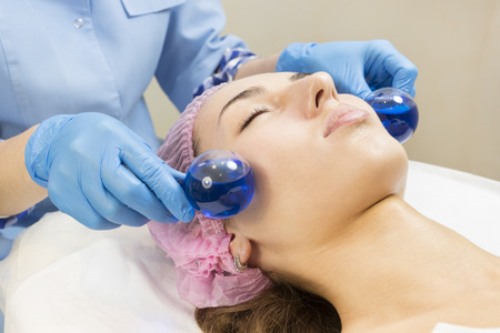 energy healing: Process cosmetic mask of massage and facials in beauty salon Stock Photo