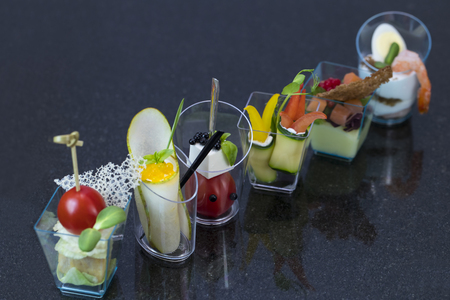 Molecular cuisine dishes in plastic buffet