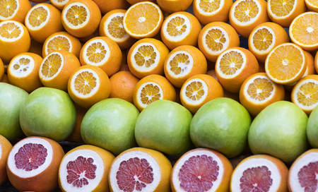 vitamine: Background of fresh fruits of pomegranate oranges kiwi, pineapple Stock Photo