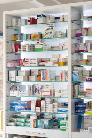 retail therapy: MARMARIS, TURKEY - 1 MAY, 2017: Pharmacy cabinets with medicines and drugs tablets and food additives