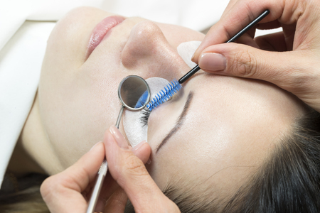The process of eyelash extensions in the beauty salon Stock Photo