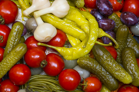 Background of pickled cucumbers, tomatoes, garlic, pepper, onions, cabbage closeup