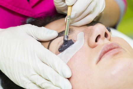 foreigner: Woman on the procedure for eyelash extensions, eyelashes lamination