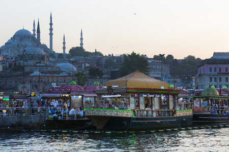 ISTANBUL, TURKEY - 2 JUNE, 2016: Food courts with traditional sandwiches with fish in Istanbul near the Galata Bridge