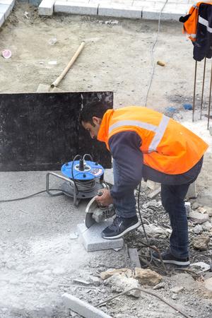 STANBUL, TURKEY - 4 APRIL 2017: Road workers repair the sidewalk in Istanbul near the Galata Bridge