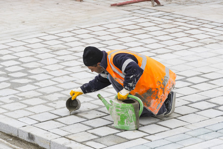 bollards: STANBUL, TURKEY - 4 APRIL 2017: Road workers repair the sidewalk in Istanbul near the Galata Bridge