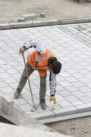 retractable: STANBUL, TURKEY - 4 APRIL 2017: Road workers repair the sidewalk in Istanbul near the Galata Bridge