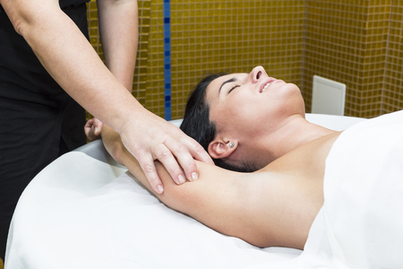 salon and spa: Woman in a beauty salon doing massage Stock Photo
