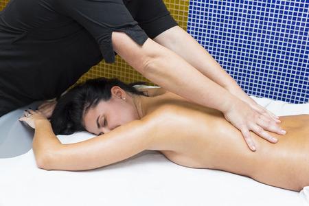 Woman in a beauty salon doing massage Stock Photo