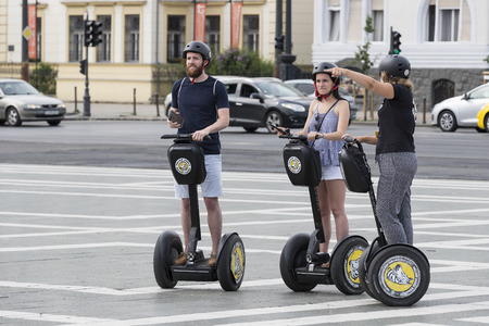 BUDAPEST, HUNGARY. 23 JUNE, 2017: Tourists on the streets of Budapest, excursion to Segway Reklamní fotografie - 81464271
