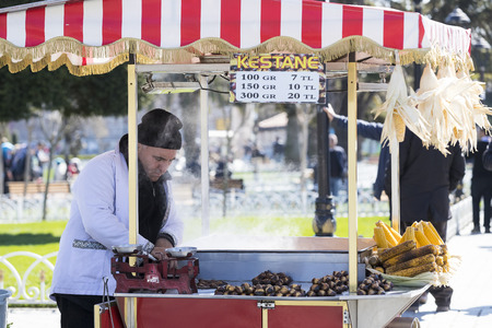 ISTANBUL, TURKEY - 1 APRIL, 2017: Sellers of fried corn chestnuts in the streets of Istanbul in Turkey