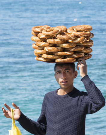 ISTANBUL, TURKEY - 1 APRIL, 2017: Street sales of traditional Turkish bagels Simit, are on the streets of Istanbul in Turkey