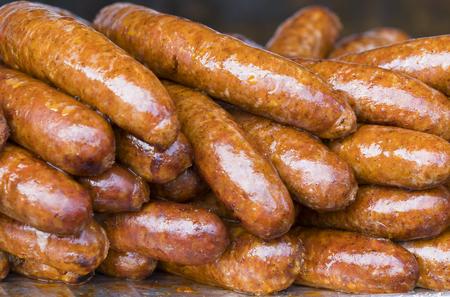 Fried delicious pork sausage shot closeup