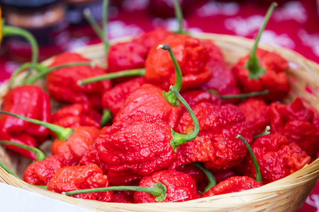 Dried paprika pods in a wicker basket close-up