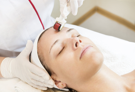 The woman undergoes the procedure. Stock Photo