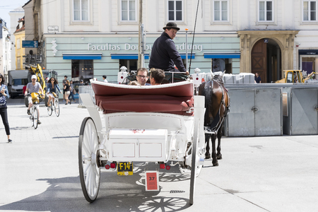 23 AUGUST 2017, VIENNA, AUSTRIA: Traditional horse-drawn carriages with cabs for tourists to walk along the ancient streets of Vienna. Editorial