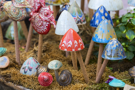 Traditional Hungarian ceramics are ceramic mushrooms for decorating pots for domestic plants. Stock Photo