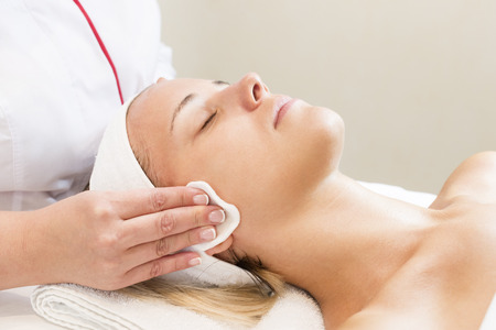release: Process cosmetic mask of massage and facials in beauty salon Stock Photo