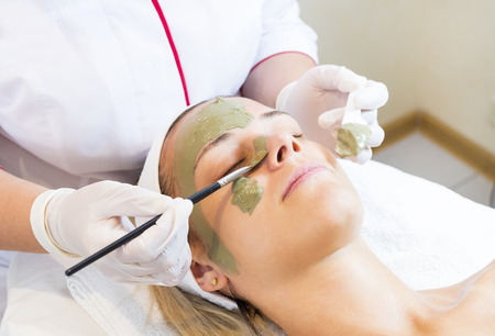 Process cosmetic mask of massage and facials in beauty salon Stock Photo