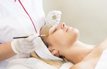 Massage and facial peels at the salon using cosmetics