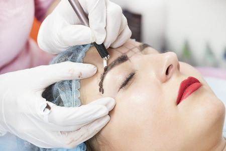 Microblading eyebrows workflow in a beauty salon Stock Photo