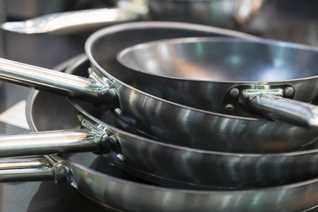 Several iron pans for cooking close-up.