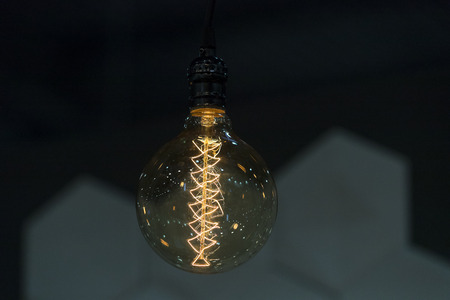 Ampoule of electric lamp on a dark background