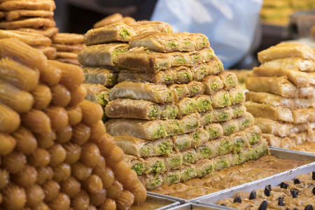 Oriental sweets baked on the market close-up photo