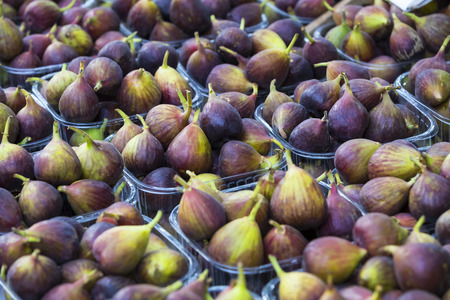 Background of ripe juicy figs on the market stalls shot closeup